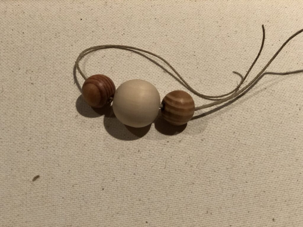 Wooden beads to make simple napkin rings for the holiday table. Thanksgiving table. Rustic wooden bead napkin ring diy