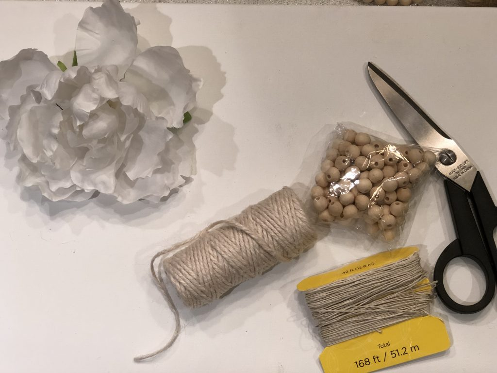 Items needed for wooden beads napkin rings. Twine, wooden beads
