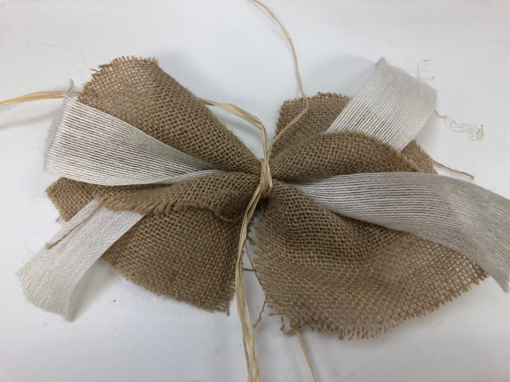 Learn how to make a bow. Rustic easy burlap, ribbon and raffia bow