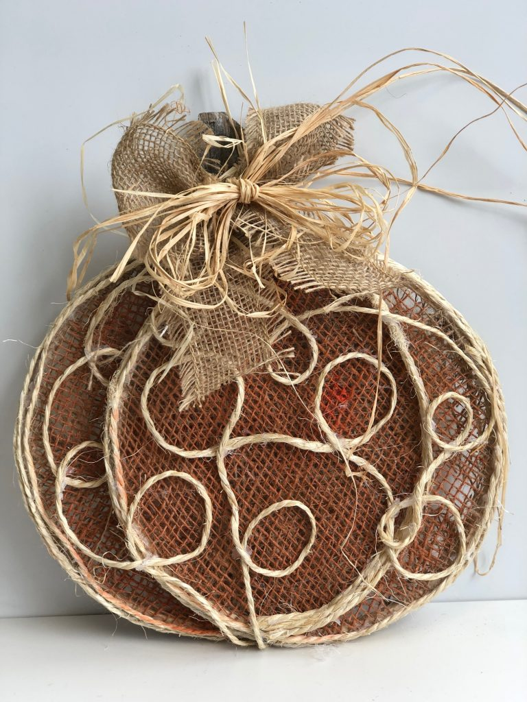 Cutest pumpkin in town! Get ready for the fall with this easy to follow DIY. Learn how to make burlap pumpkin with burlap and raffia bow. #falldecor #falldiy #rustic #embroideryhoopdiy