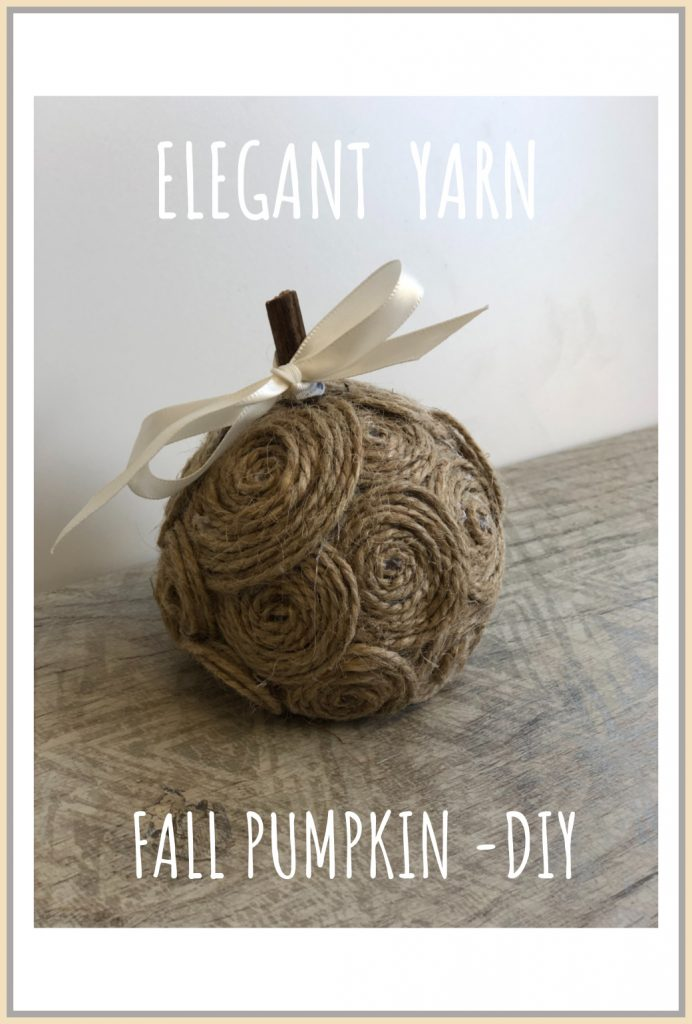 Stunning elegant white ,tan and orange mini pumpkins made out of yarn or twine. Simple satin bow. Sophisticated  fall decor.
