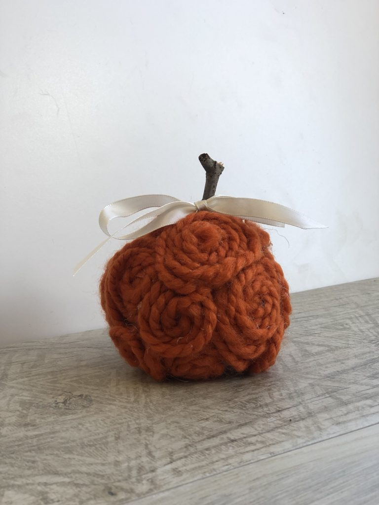 Stunning, elegant orange mini pumpkins made out of yarn. Simple satin bow. Fall decor diy