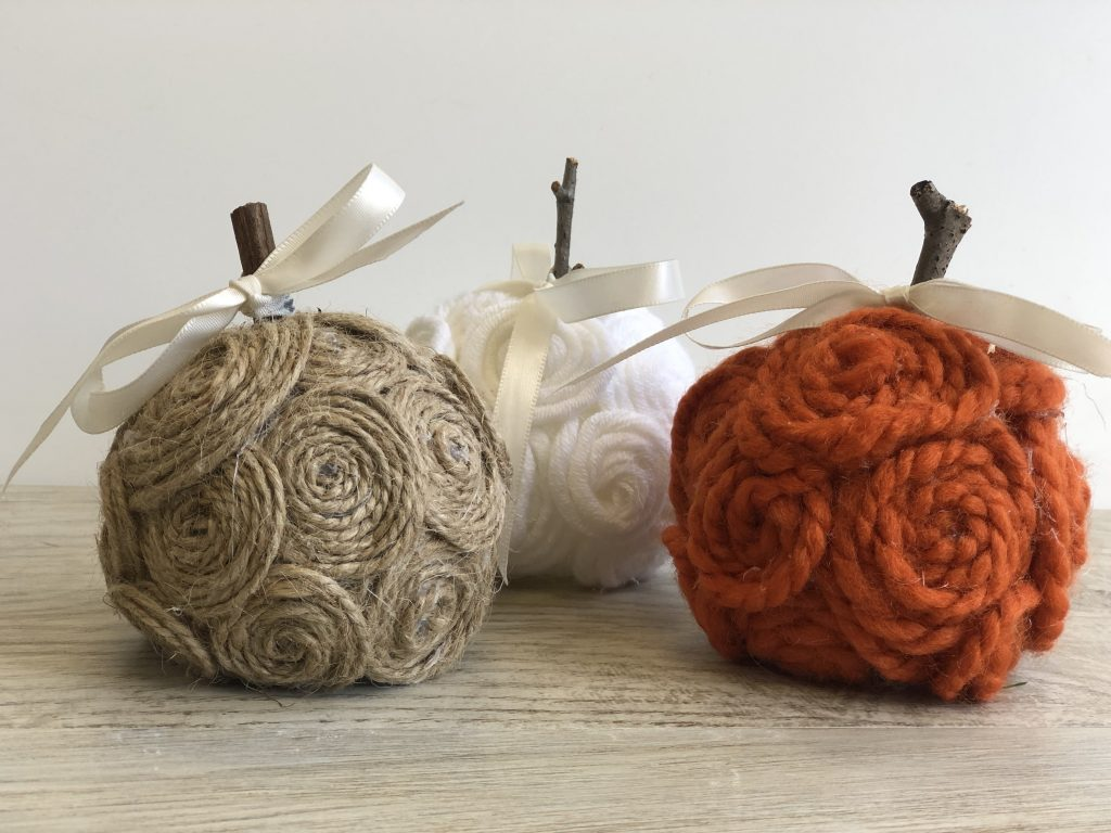 Stunning elegant white ,tan and orange mini pumpkins made out of twine.