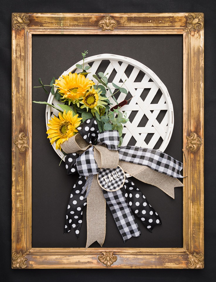 Sunflower wreath with buffalo check bow.