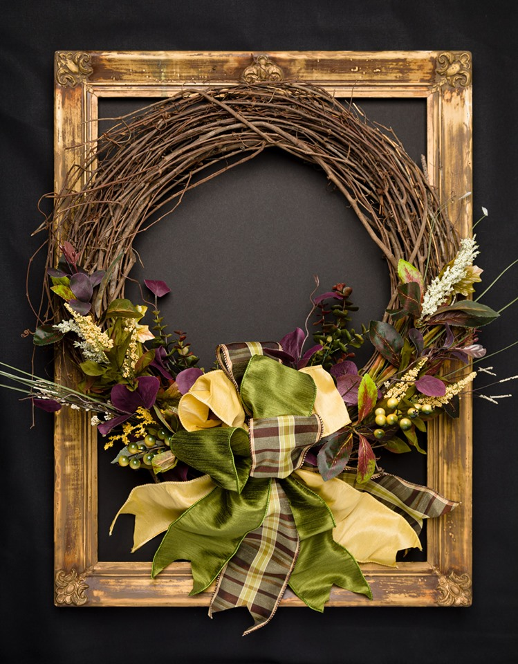 Elegant grapevine fall wreath with stunning Dupioni ribbon bow.