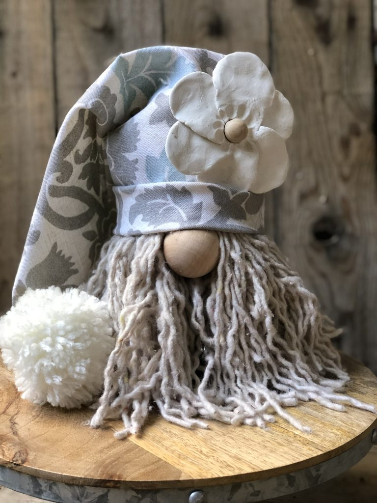 Easy Gnome DIY with daisy flower hat. Fall Gnome. Christmas gnome. Summer Gnome.Adorable easy to make holiday Dollar Tree gnome DIY. Thrifty way to decorate this Christmas. Learn how to make a gnome. Fall gnome