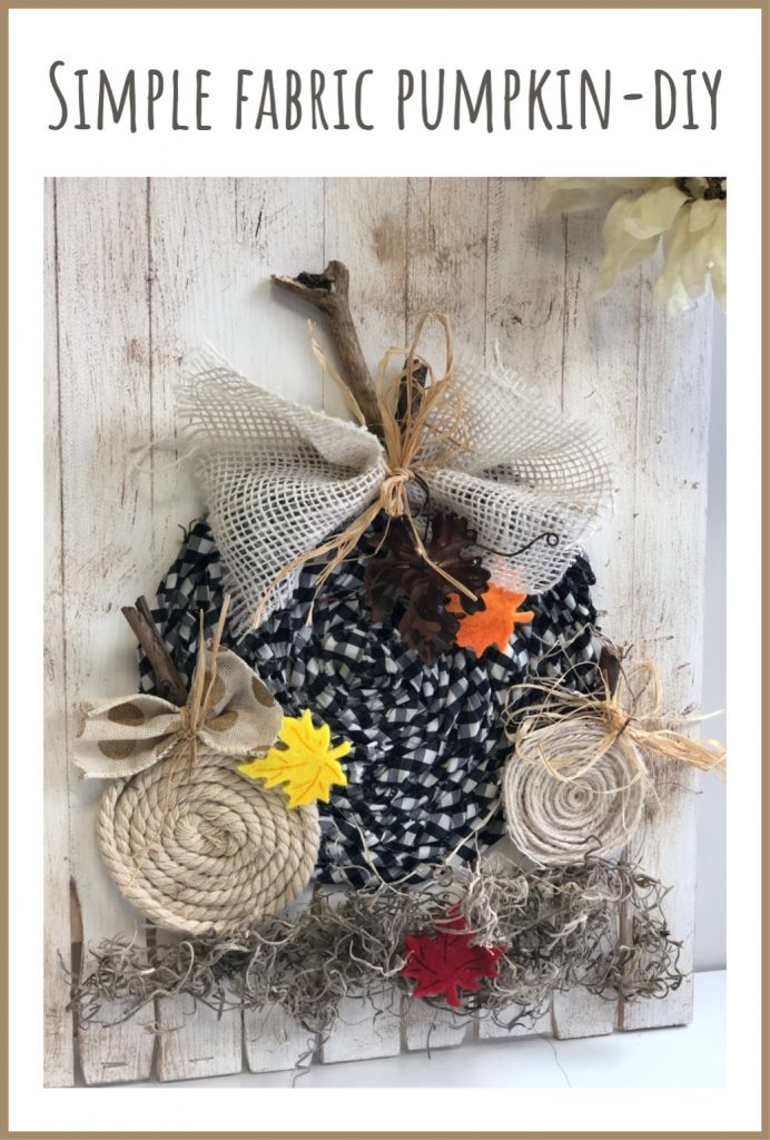 Buffalo check fabric pumpkin on the wooden board. Easy fall tutorial. Easy bow tutorial #fallpumpkin #fabricpumpkin #fallhomedecor #fallidea #buffalocheckpumpkin #buffalocheck