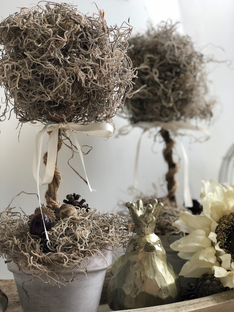 Love the look of topiary ball trees, but don't want to pay the high price tag? Here's a way to make DIY topiary trees from Dollar Tree supplies!  Let's make a moss ball topiary diy, which is also perfect for year round decor.