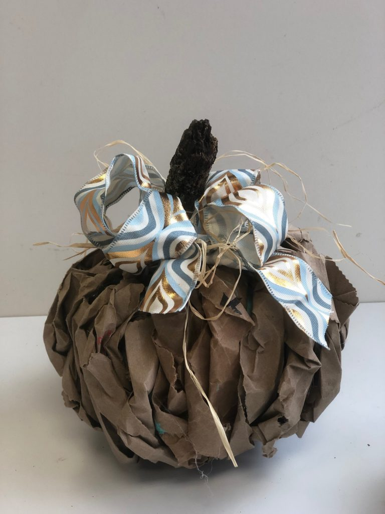 Brown paper lunch bag pumpkin diy. Easy to follow instructionsTeal Pumpkin Project! Brown paper fall decor diy.  Teal easy pumpkin diy. Messy bow. Paper fall decor pumpkin diy