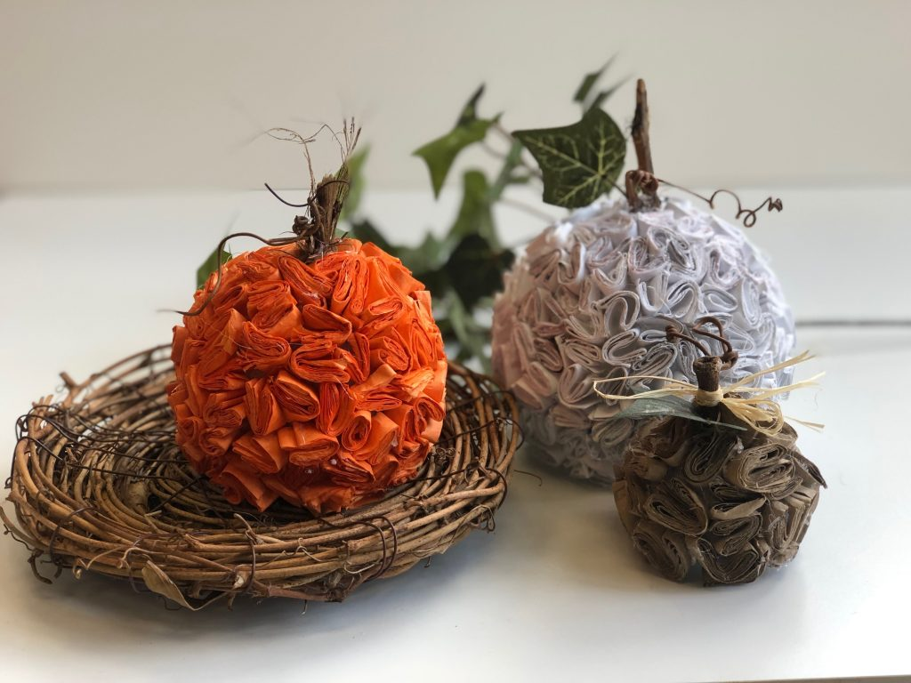 Learn how to make stunning pumpkins out of recycled paper. Super easy DIY. Textured paper pumpkin