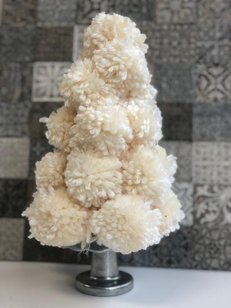 Christmas tree made out of pom-pom. Simple supplies needed to create festive Christmas decor