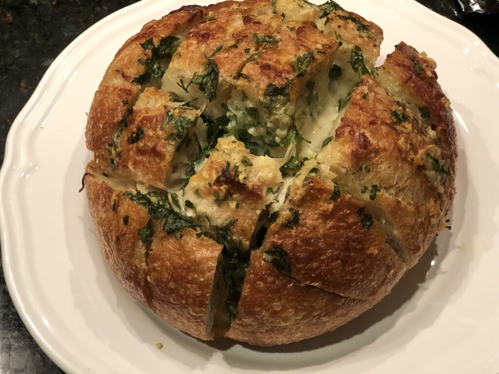 Guaranteed to be the most popular side dish at any gathering. Garlic and cheese pull apart bread. Thanksgiving side dish