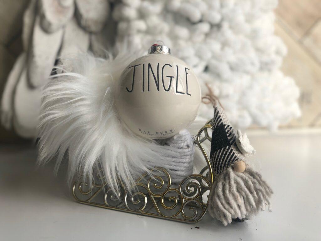 Dollar tree Santa sleigh makeover. Fur trim. Pine cone gnome diy. Rae Dunn ornaments