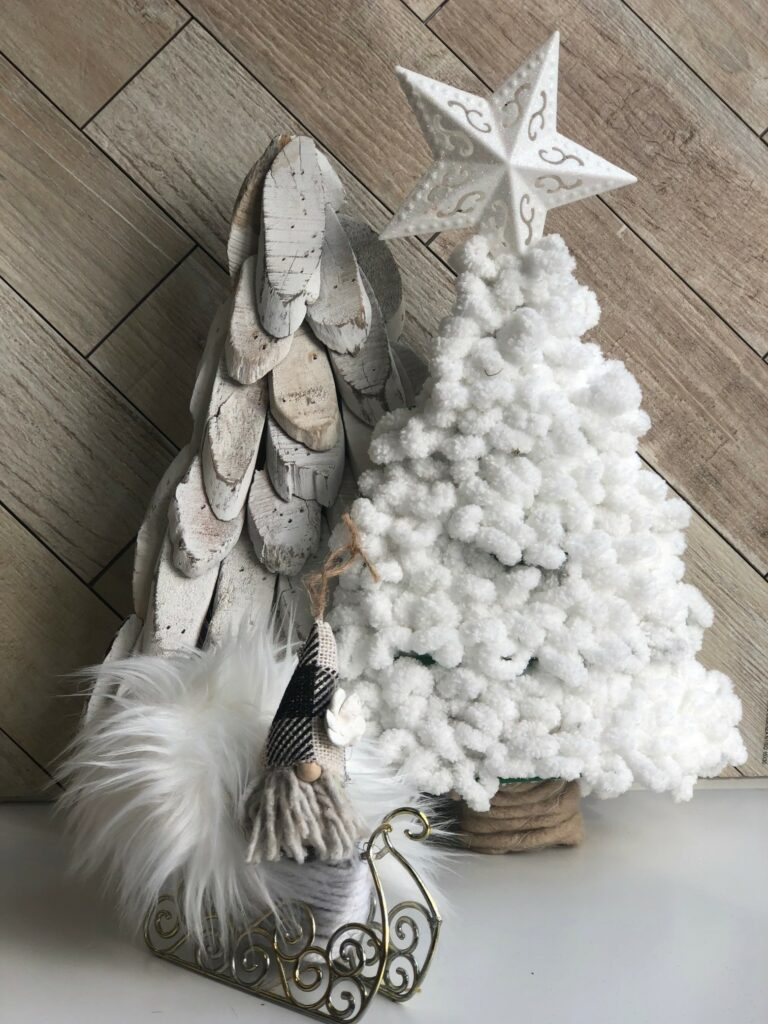Learn how to turn inexpensive Dollar Tree merchandise into upscale Christmas decor!  White chunky yarn Christmas tree diy.