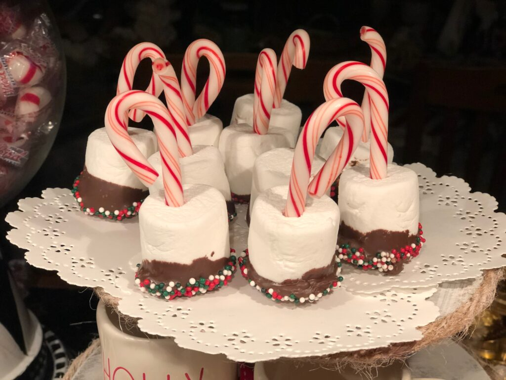 Marshmallows dipped in the chocolate with candy cane. Dollar Tree hot cocoa bar