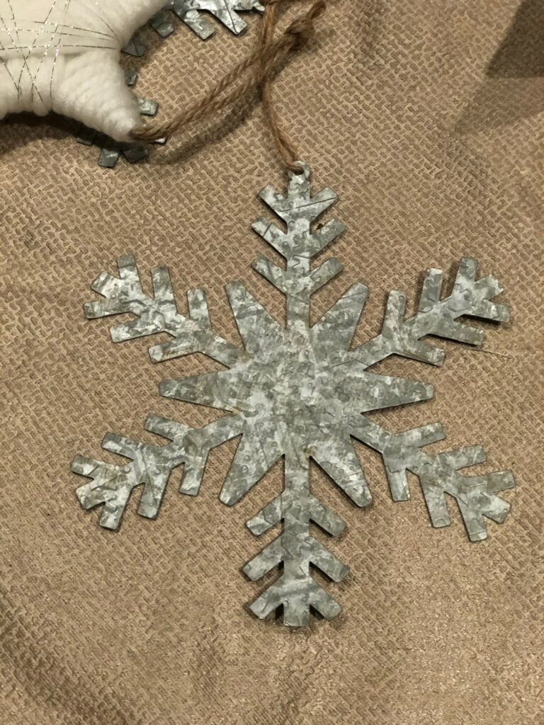 Galvanized snowflake to decorate Candy Cane Christmas Wreath
