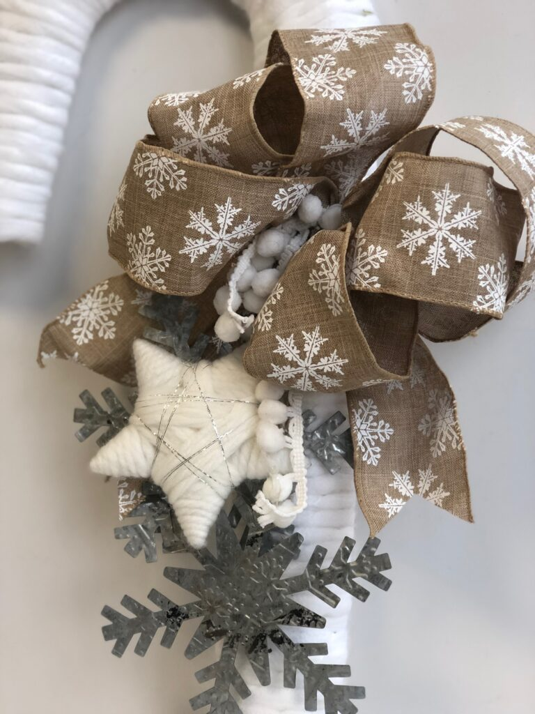 Simple folded rustic easy bow to decorate your Christmas wreath. Bow with snowflake charms