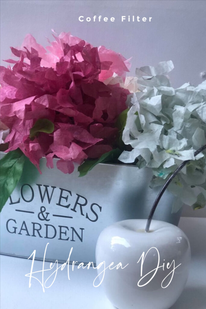 Learn how to make Super Chic Hydrangea flowers out of coffee filters. Super easy directions to follow. Evergreen elegant home decor idea