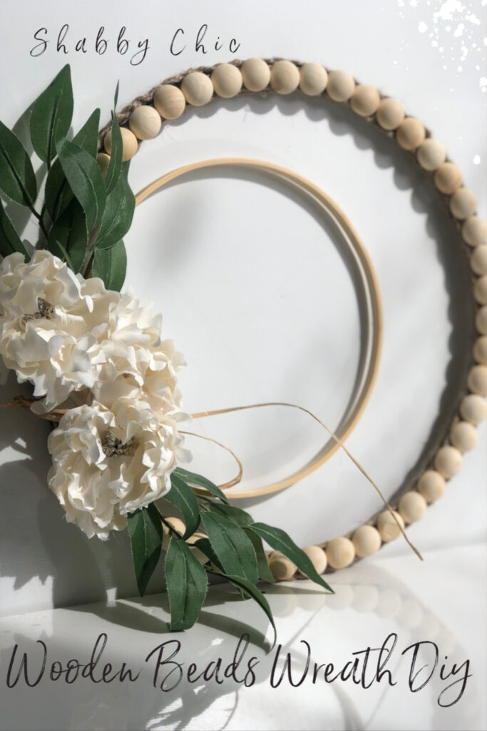 Shabby Chic super easy to make sliced wooden beads embroidery hoop wreath DIY will add lots of detail into your home. Must have evergreen wreath