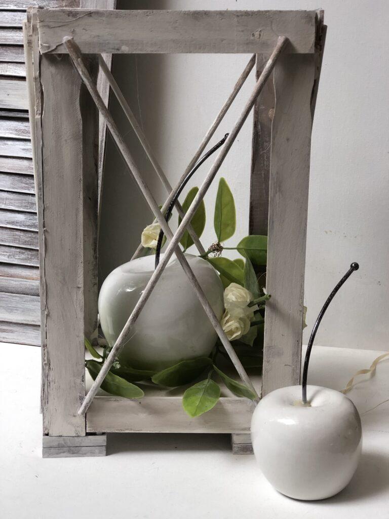Learn how to make an easy wood lantern. Rustic Wood Lantern under $3 Dollar Tree home decor diy .Paint stir sticks lantern diy