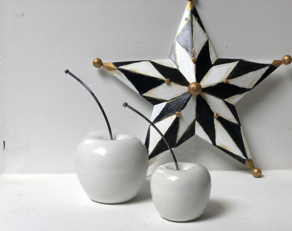 McKenzie Childs inspired Home decor idea. Black and white pattern star diy. Learn how you can use Elmer's glue to crackle paint on the wood? This Dollar Tree butterfly DIY is a must project o make