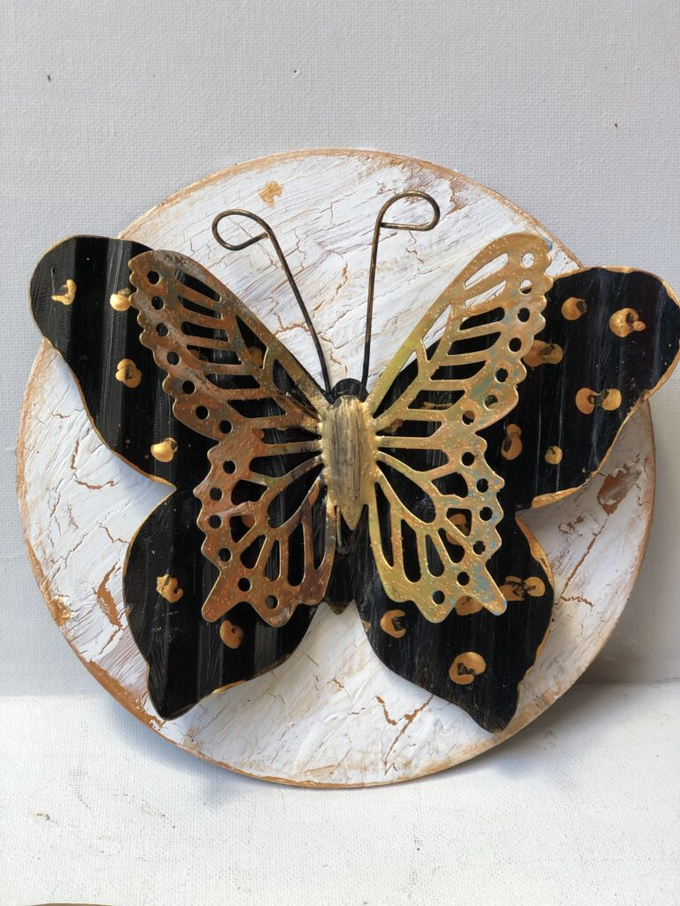Learn how you can use Elmer's glue to crackle paint on the wood? This Dollar Tree butterfly DIY is a must project o make