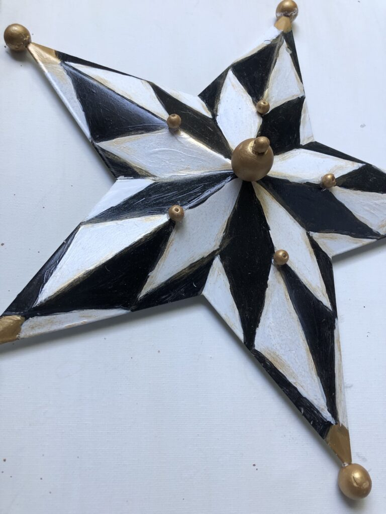 MacKenzie-Childs inspired home decor diy. Harlequin pattern star. Black and white elegant pattern diy. How to paint checkered pattern.