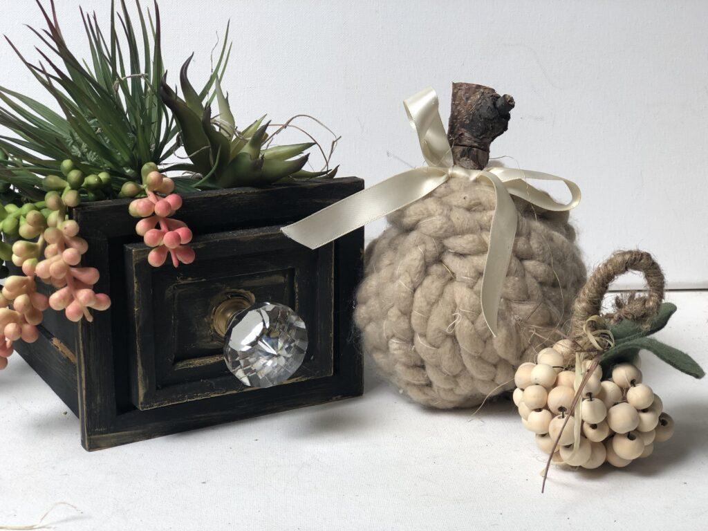 Super cute Dollar Tree chunk yarn braided pumpkin. Braided chunky yarn fall decor idea. Cozy chunky yarn fall project