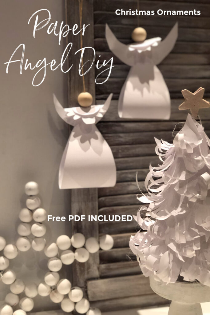 Learn how to make stunning Christmas ornaments out of paper. White paper Angel Christmas ornament with wooden bead diy.. PDF file included