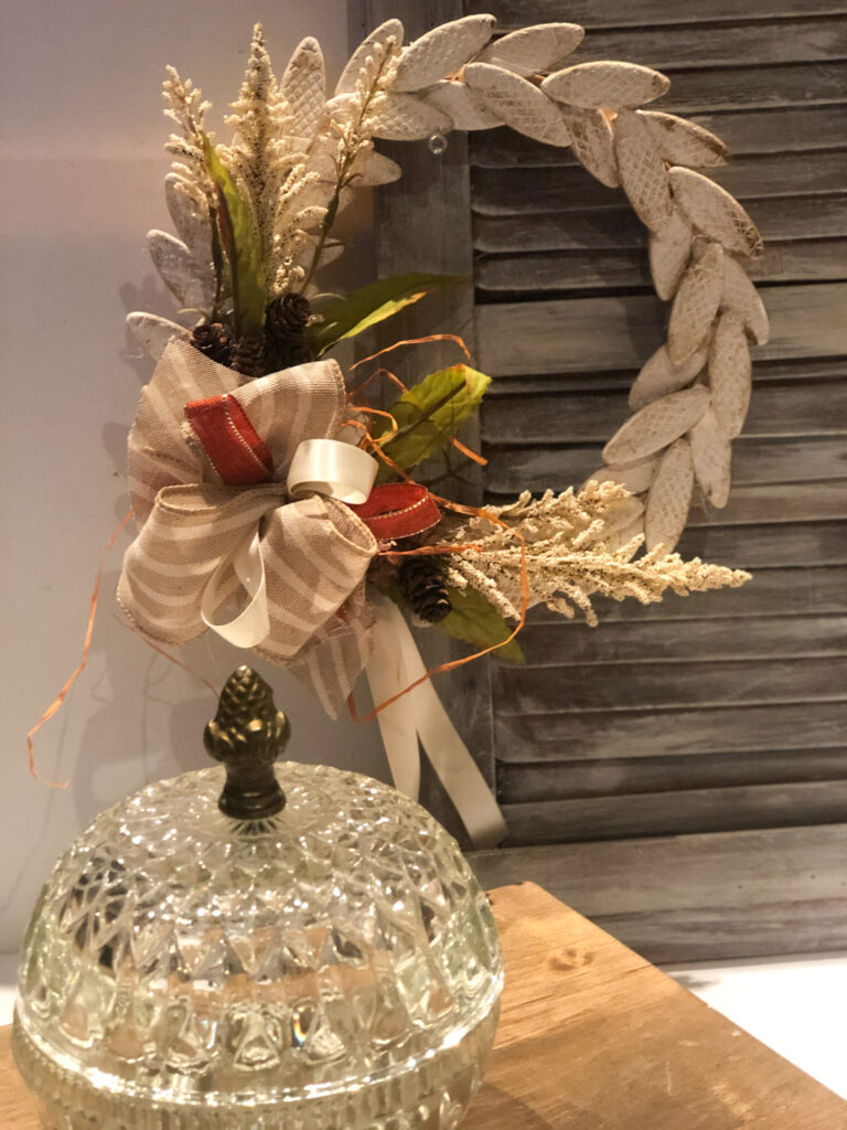 Learn how to make weaved wooden biscuits wreath perfect for fall decor. Easy wooden biscuits evergreen wreath with bow