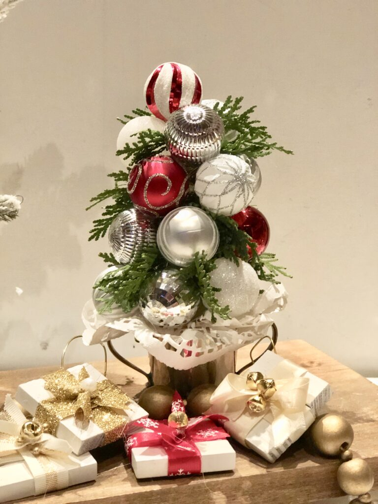 Make this stunning Candy Cane Christmas tree out of ribbon. Budget friendly Christmas DIY. Ribbon Christmas tree craft. Mini Candy cane tree topper