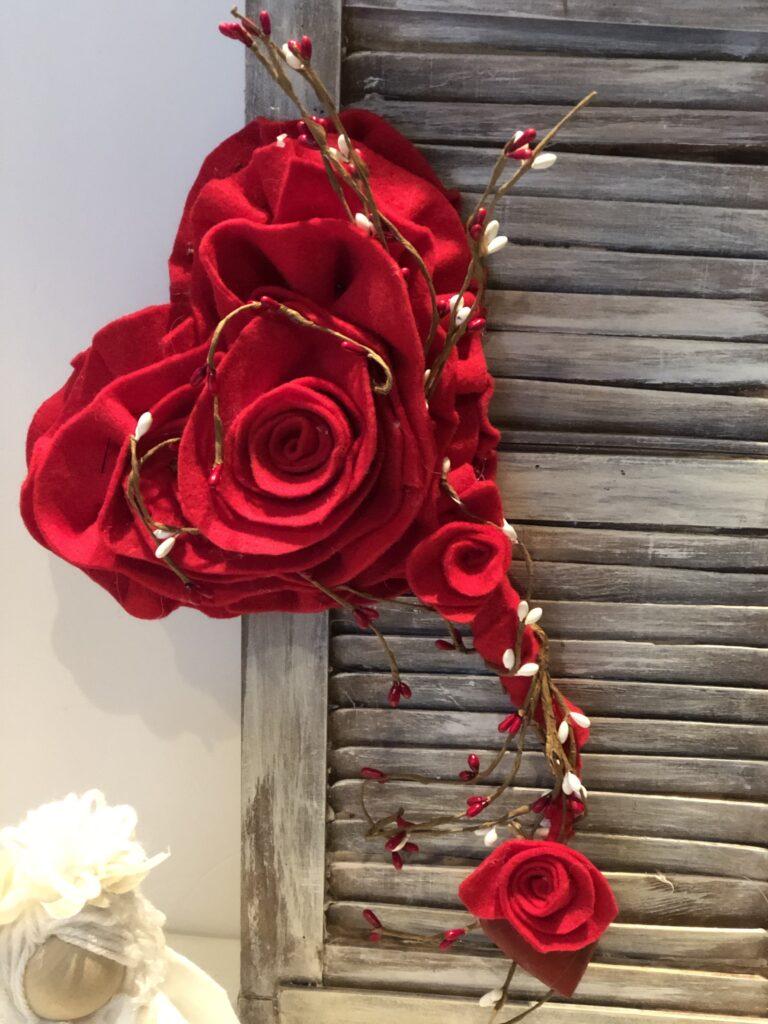 Stunning felt Valentine Day decor. Learn how to make easy rose. Felt heart rose diy. Dollar Tree upscale makeover diy . Felt heart on the rustic Shutters
