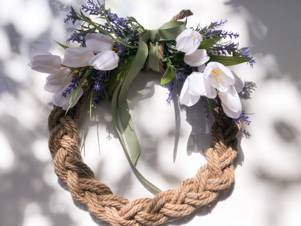 Learn how to make elegant spring front door wreath on the budget. Dollar Tree nautical rope braided wreath diy